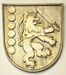 Geschnitztes Wappen der Gemeinde Držkov