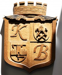 Dřevěný vyřezávaná znak pro společnosti Gleeds